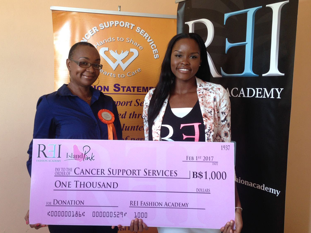 """""""Cancer Support Services is indeed grateful to REI Fashion Academy for their unwavering support of the Charity's programmes over the years.  On Wednesday February 1, 2017 REI's #IslandPink Ambassador Megghan Michael presented the President of Cancer Support Services Ms. Kathy-Ann Kelly-Springer with a donation of $1,000.00 towards the Charity's on-going programmes."""""""